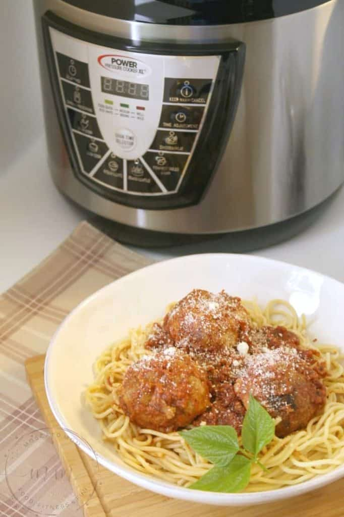pressure cooker meatballs in front of power pressure cooker xl