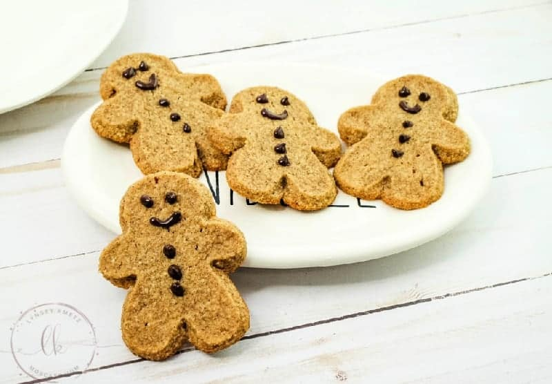 four low carb gingerbread cookies on a white plate