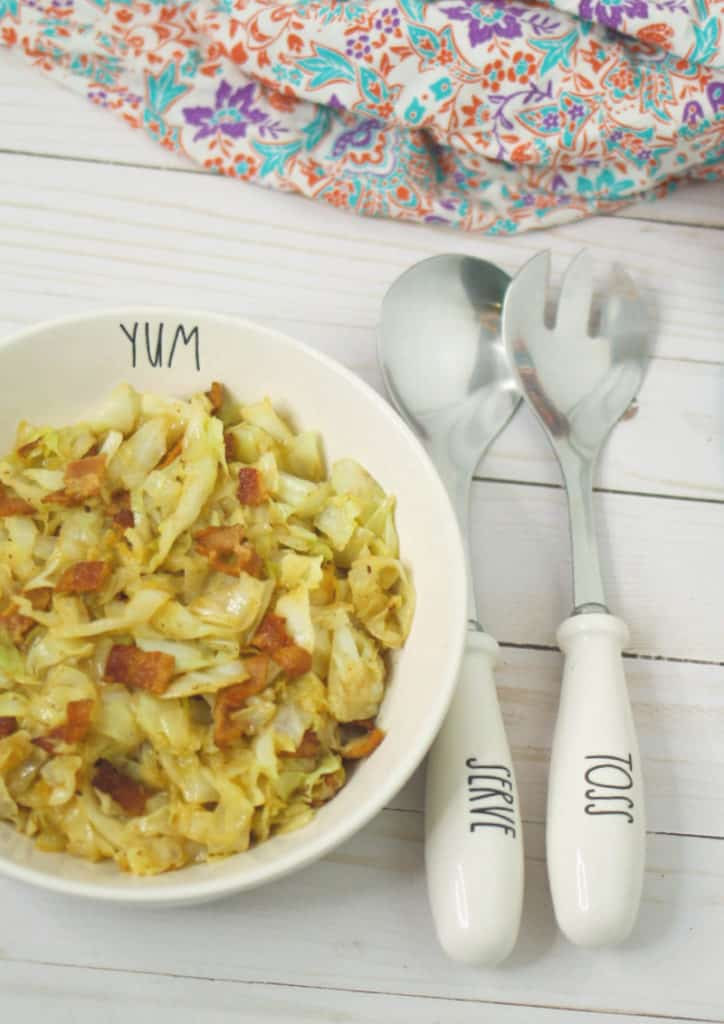 place setting with keto fried cabbage with bacon side dish
