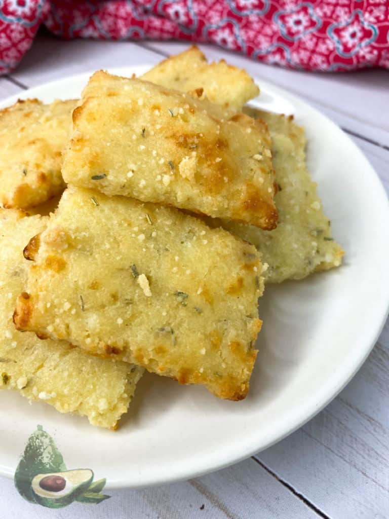 low carb crackers on a white plate with a red napkin