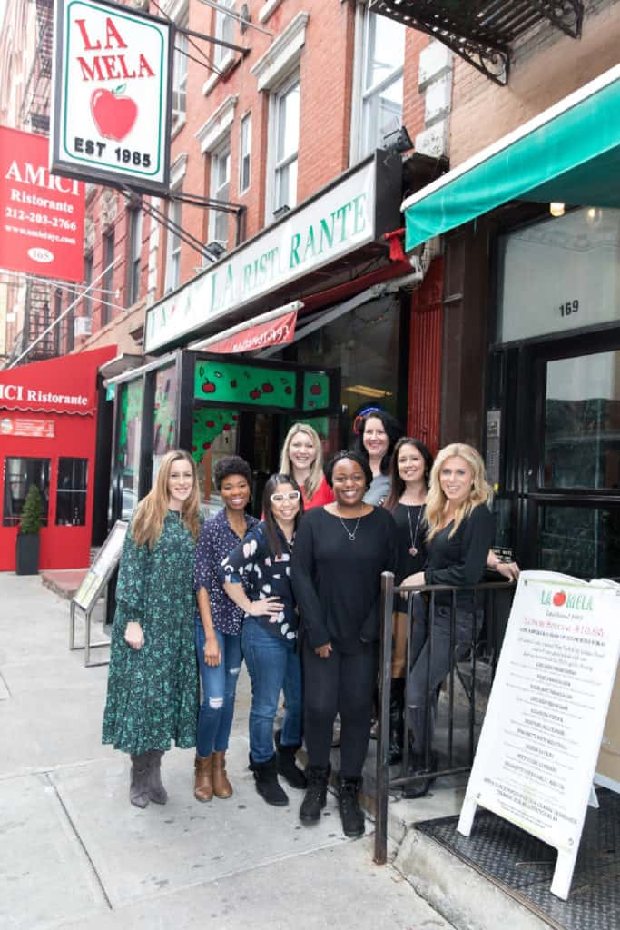 mastermind group of women in front of la mela nyc