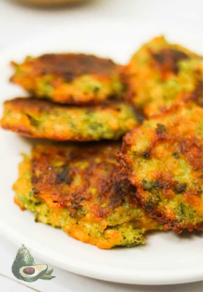 close up keto broccoli fritters on white plate