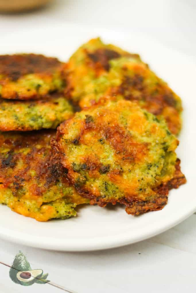 browned broccoli fritters on a white plate