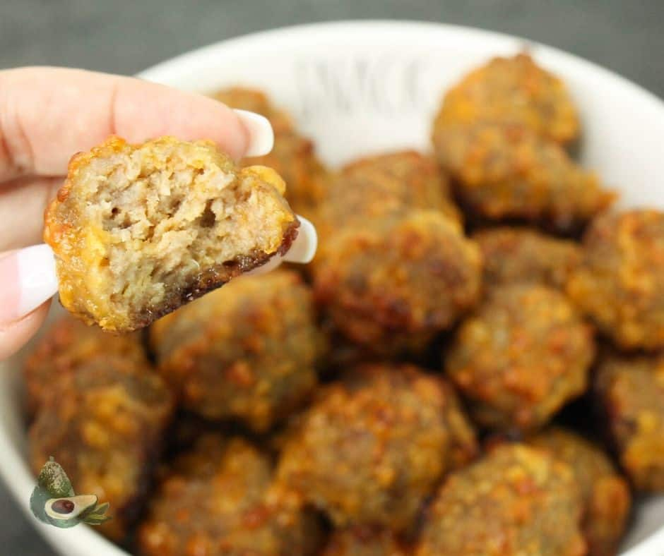 close up sausage ball with bite missing on dark background