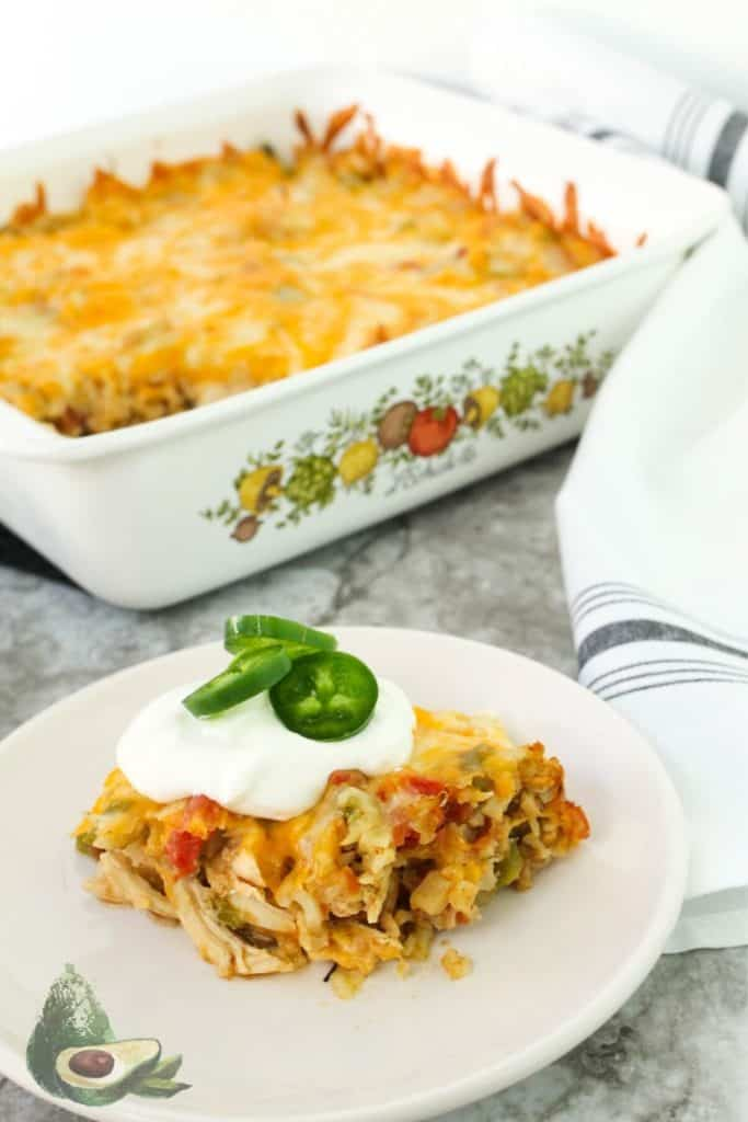 low carb mexican casserole on white plate with white napkin
