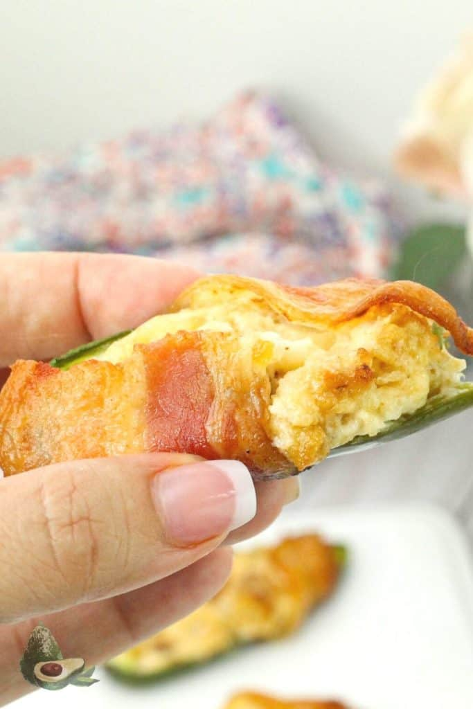 womans hand holding jalapeno popper