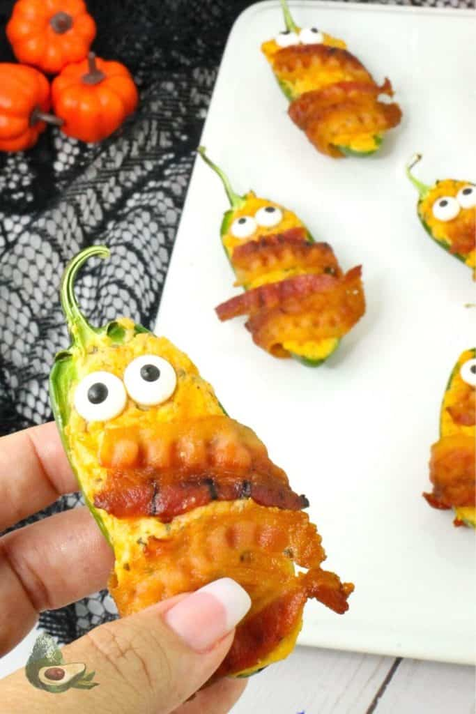 close up of jalapeno popper mummies with halloween decorations