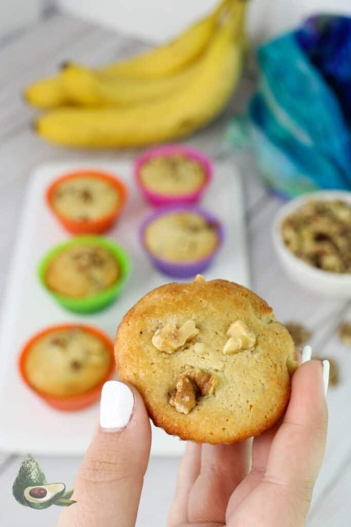 hand holding keto banana nut muffin