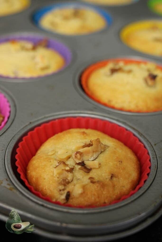 close up baked low carb banana muffin in red liner