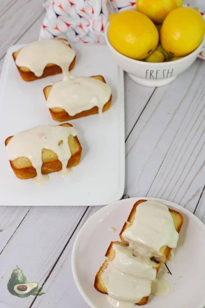 overhead keto lemon loaf with glaze and bowl of fresh lemons
