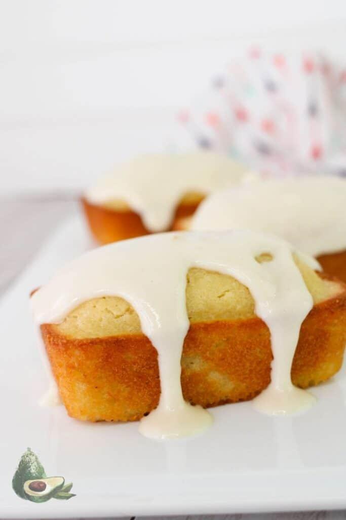 close up small lemon loaf with glaze