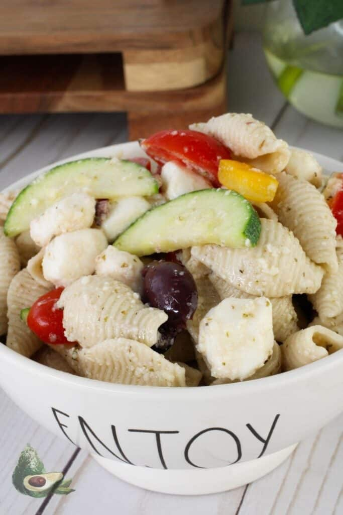 keto greek salad with pasta in a white bowl