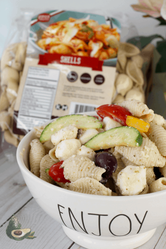 greek keto pasta salad with low carb pasta bag in background